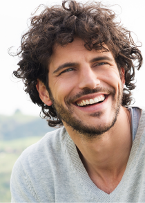 A man with curly and a nice smile